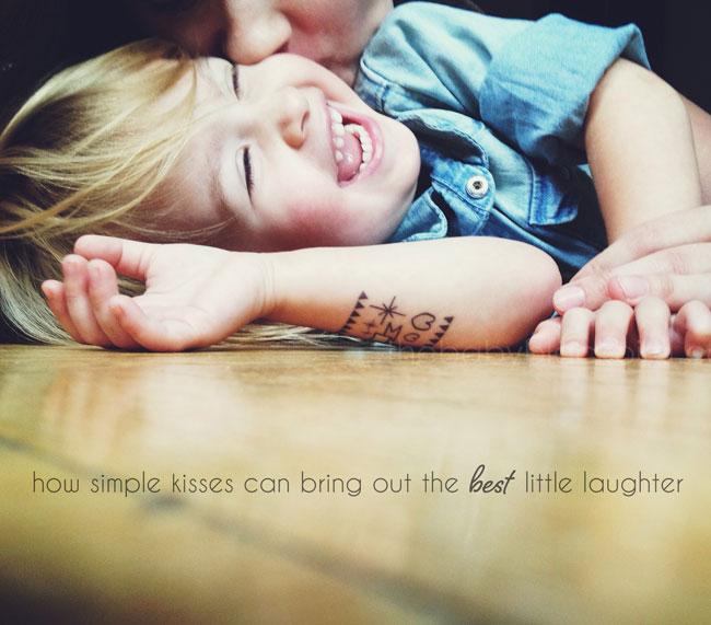 little kid laughs, mommy kisses