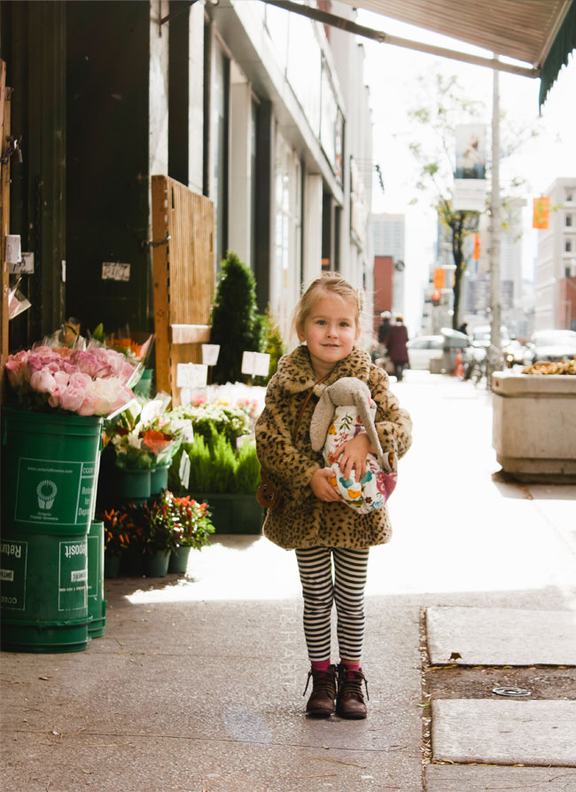 little-girl-playing-pretend-in-the-city