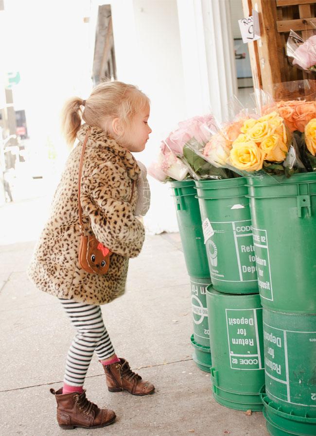 little-girl-smelling-roses