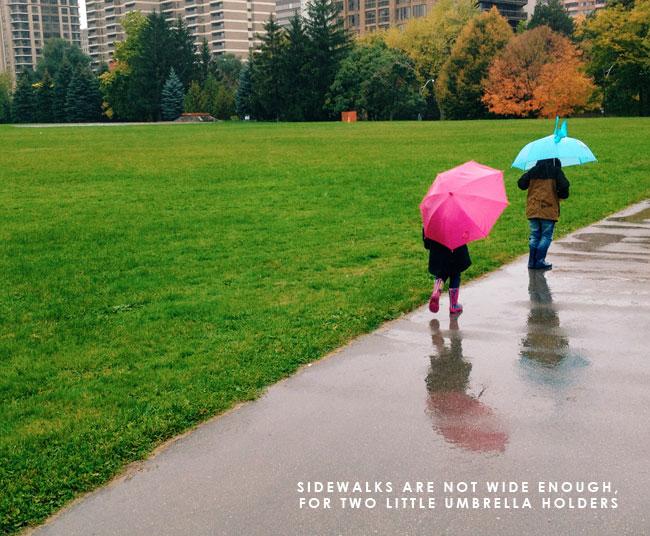 kids-walking-with-umbrellas