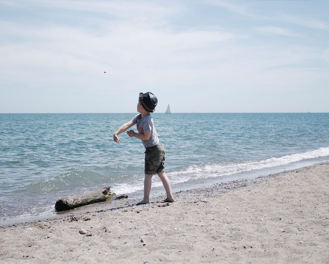 throwing rocks in the lake